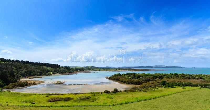 A Bay in the Bay of Islands, New Zealand, on a beautiful summer day. A panoramic view of Wairoa Bay, Bay of Islands, New Zealand. This area is on the mainland stock photos