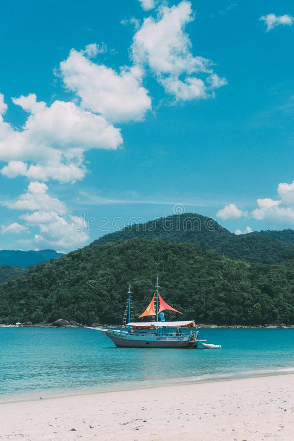 Bay, Beach, Boat, Cliff royalty free stock photography