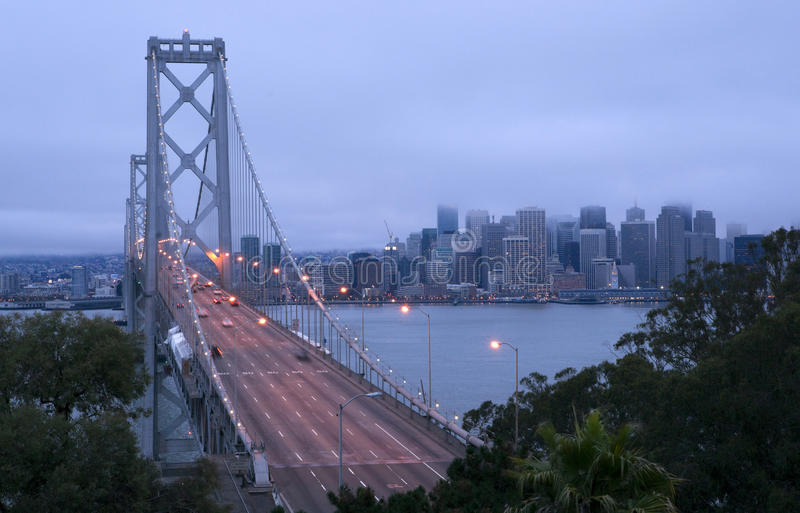 Download The Bay Bridge Carries Automaobiles Through Fog Do Stock Photo - Image: 26953910