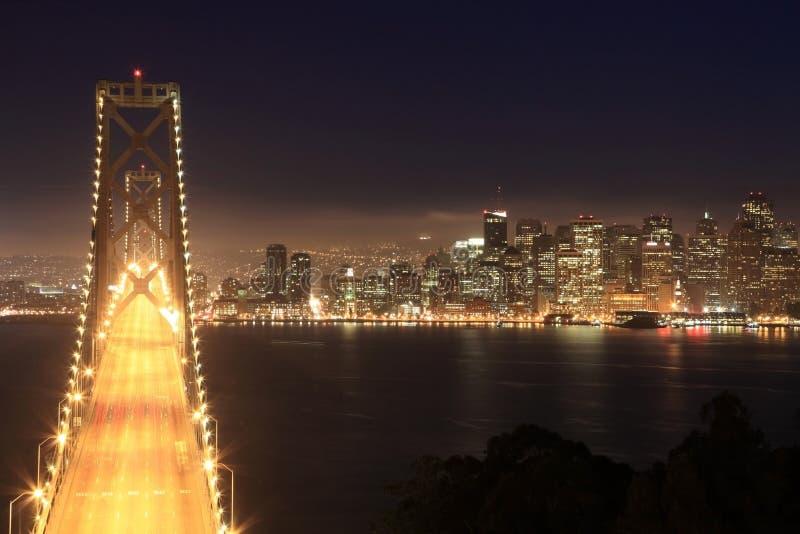 Bay Bridge & San Francisco at night stock images