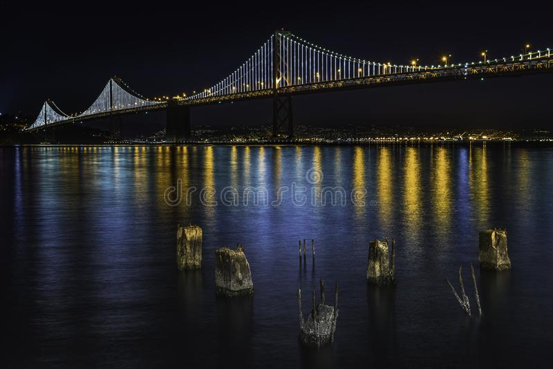 The Bay Bridge San Francisco. The Bay Bridge was lit up in San Francisco Bay royalty free stock photography