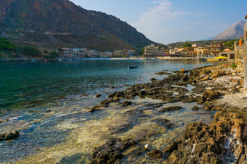 Bay of Gerolimenas village in Mani, Greece. Bay with crystal waters and boats in Mani of Peloponnese in Greece stock image