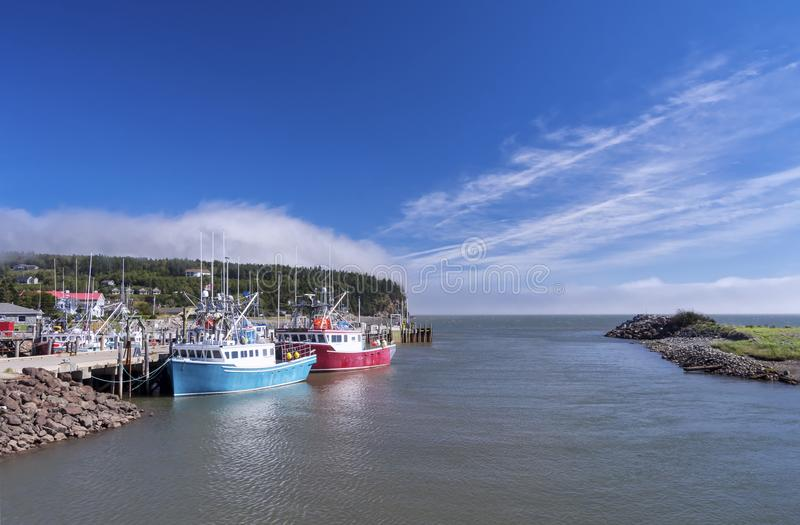 Bay of Fundy, New Brunswick, Canada. Fishing boats in the town of Alama, Fundy National Park, New Brunswick, Canada stock photos