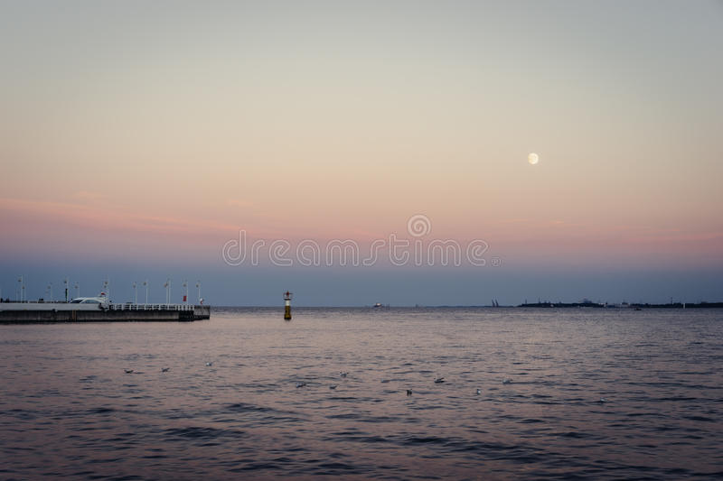 Bay of Gdansk, Poland. Quiet evening with full moon by the bay of Gdansk, Pomeranian, Poland royalty free stock images