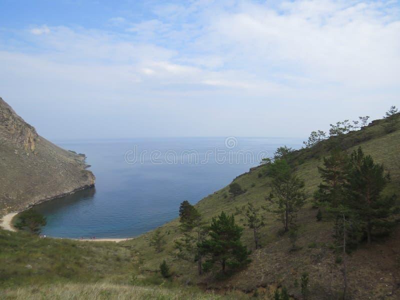 Bay Halsany. The view from the top. Olkhon Island. Lake Baikal. Bay Halsany. Sandy beach on a summer day. The view from the top. Olkhon Island. Lake Baikal royalty free stock image