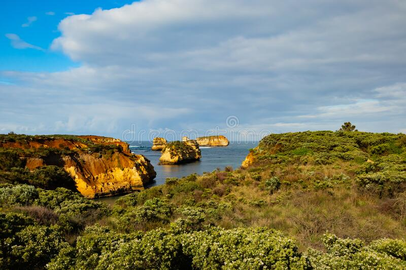 Bay of Islands on the Great Ocean Road. Rock formation in the ocean. Rocks covered by bushes. Australia landscape. Victoria,. Bay of Islands on the Great Ocean royalty free stock photo