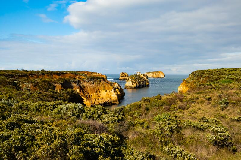 Bay of Islands on the Great Ocean Road. Rock formation in the ocean. Rocks covered by bushes. Australia landscape. Victoria,. Bay of Islands on the Great Ocean stock photography