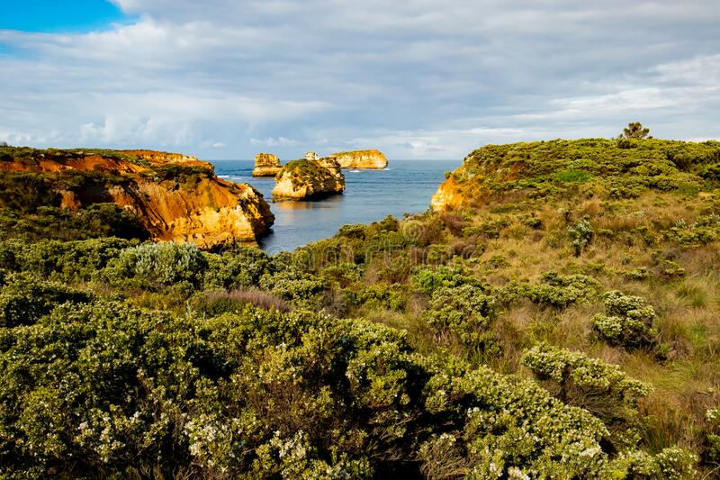 Bay of Islands on the Great Ocean Road. Rock formation in the ocean. Rocks covered by bushes. Australia landscape. Victoria,. Bay of Islands on the Great Ocean stock images