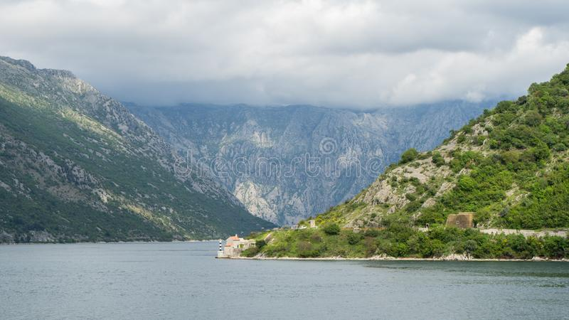 Bay of Kotor. View from the road. Mountains and bay in Montenegro. Scenic Landscape with a big lake and mountain with clouds and. Green forest, sea, adriatic stock image