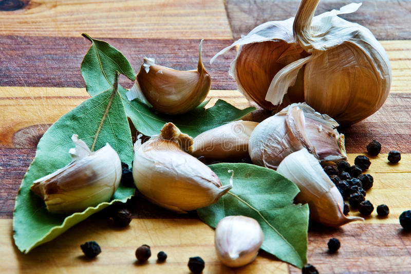 Bay leaf, pepper and garlic royalty free stock image
