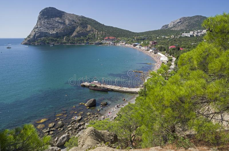 A small bay on the Black Sea coast. Crimea. The bay of Novy Svet village, Crimea. Sunny summer day royalty free stock photos
