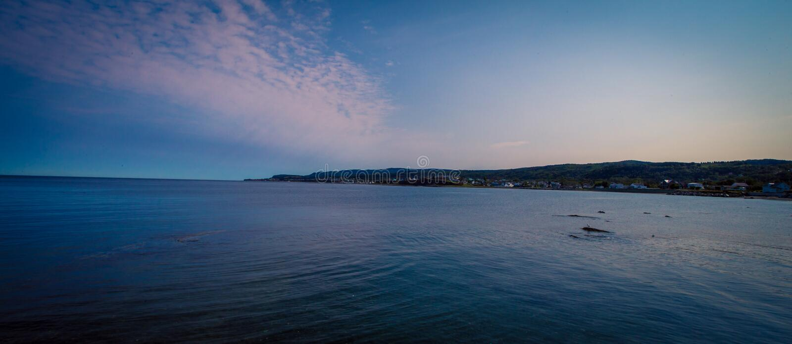 Bay in Quebec Canada. The calm water in the Gaspe Bay Quebec Canada stock photo