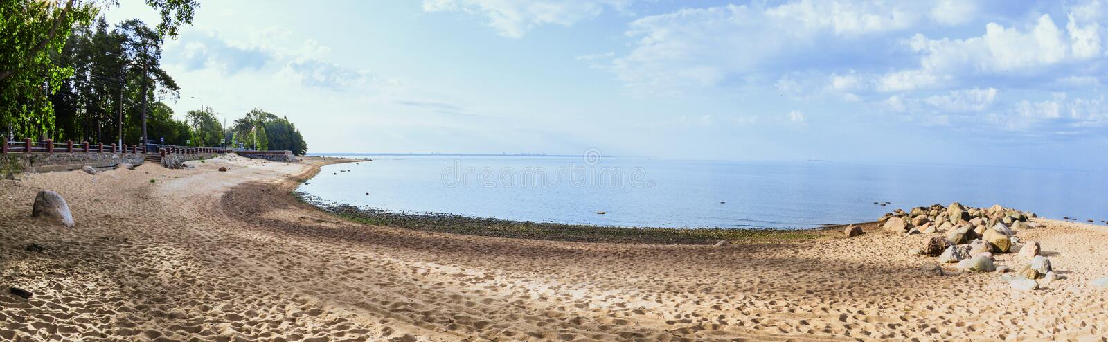 Bay shore on an early summer morning. Peace and quiet on a deserted beach stock photography