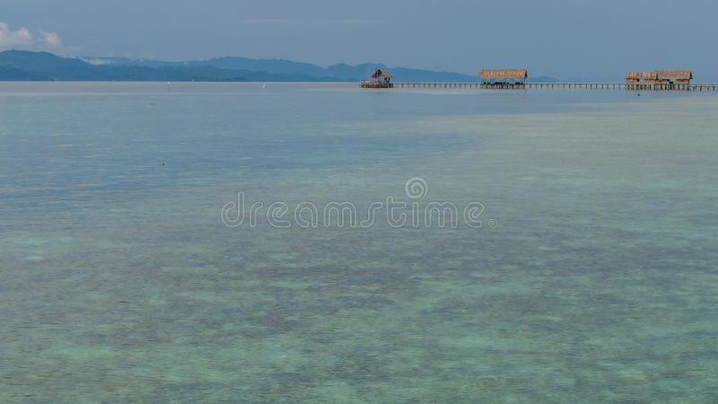 Bay with Underwater Corals in Front of Diving Station and Guesthouses on Kri Island, Raja Ampat, Indonesia, West Papua.  royalty free stock photos