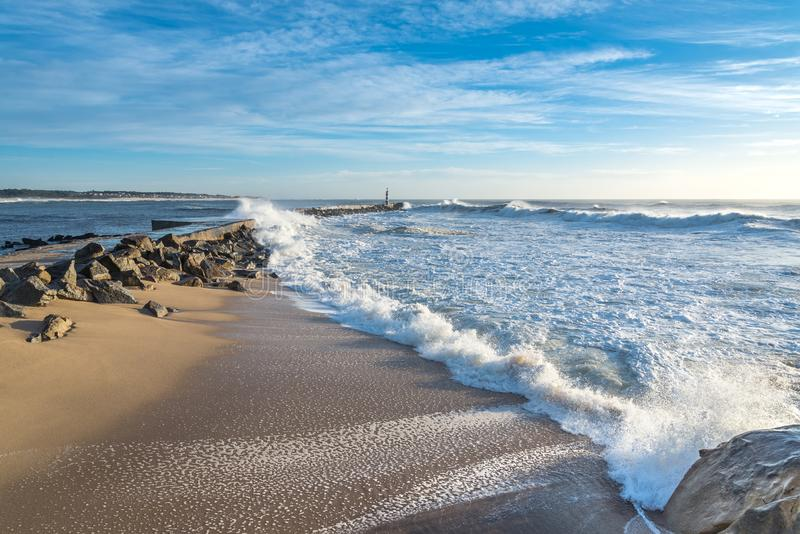Seascape photography the bay of Vila do Conde. View of the lighthouse and the bay of Vila do Conde city in north of Portugal sunny day intense colors stock photo