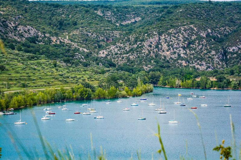 Bay of village Bauduen on the lake shore, Provence, France with yachts boats. Bay of village Bauduen on the lake shore, Provence, France with anchored yachts stock image