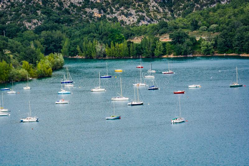Bay of village Bauduen on the lake shore, Provence, France with yachts boats. Bay of village Bauduen on the lake shore, Provence, France with anchored yachts royalty free stock photos