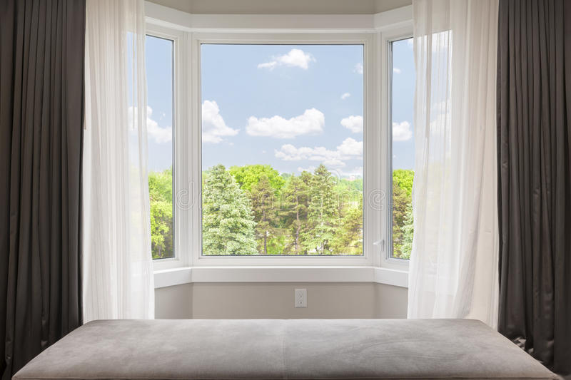 Bay window with summer view stock images