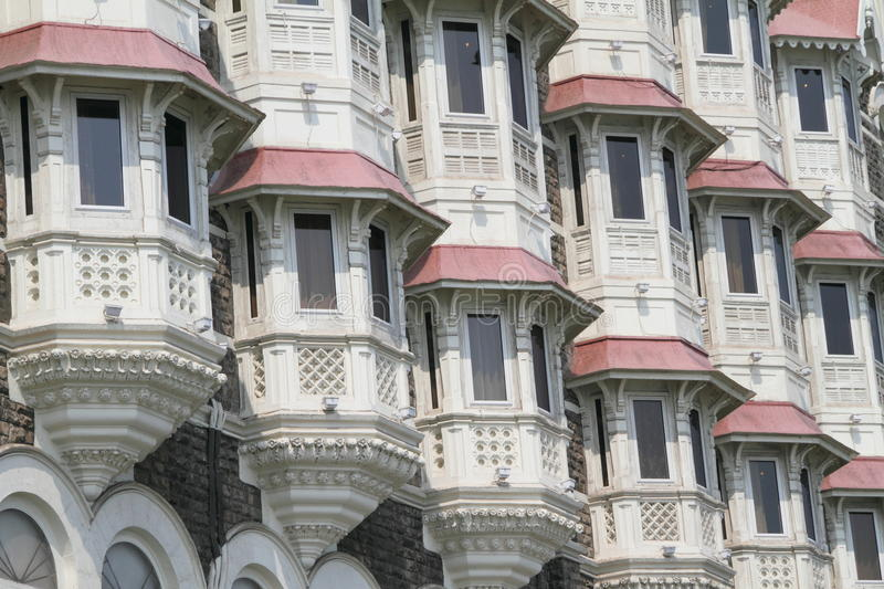 Bay windows. Repetition of bay windows, detail of famous luxury hotel Taj Mahal in Mumbai (Bombay), India royalty free stock image