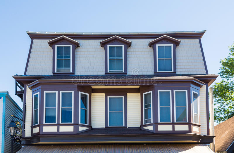 Bay Windows and Dormers. On wood building stock photos