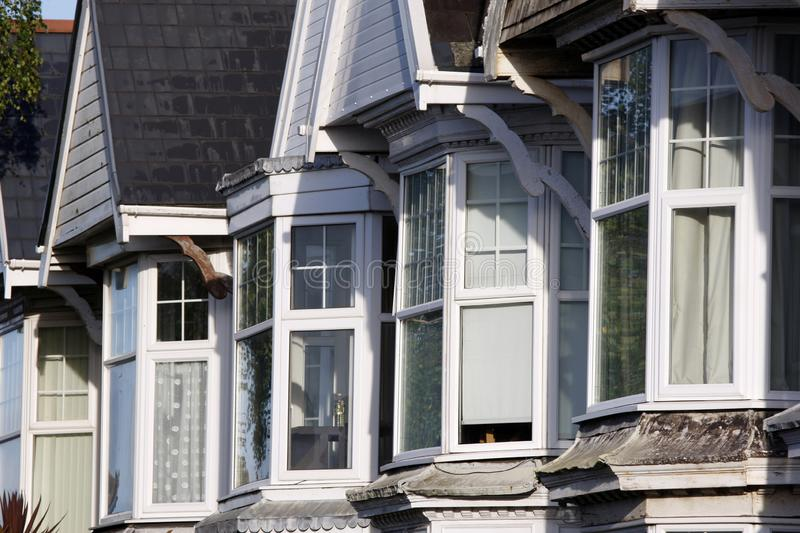 Bay windows in an Edwardian terraced street. Upper bay windows in an Edwardian terraced street stock photography