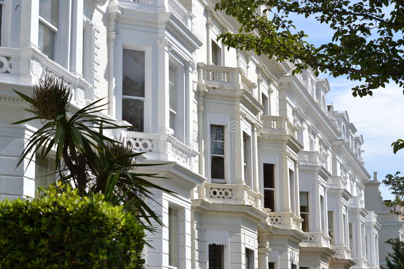 Bay windows grand villas Notting Hill London. Stuccoed fronts and bay windows of grand villas in Notting Hill , London upmarket Pembridge Square area royalty free stock photography