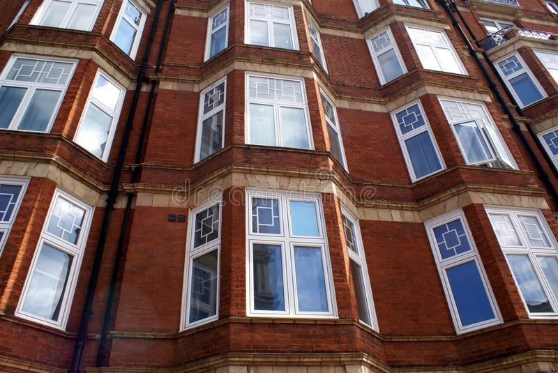 Bay windows. Outdoor view of architecture of bay windows, facade, or an exterior stock image