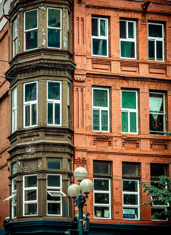 Bay Windows on Red Brick. Apartment Building stock image