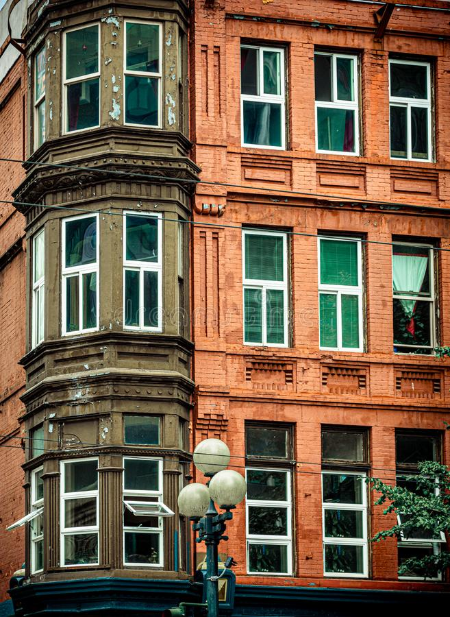 Bay Windows on Red Brick. Apartment Building stock images