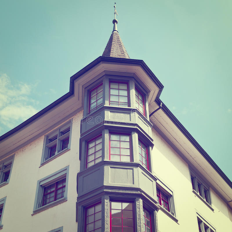 Bay Windows. Renovated Facade of the Old Swiss House with Bay Windows, Instagram Effect royalty free stock image
