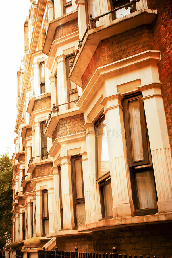 Bay windows. Row of georgian style houses in London with bay windows, in warm tones royalty free stock image