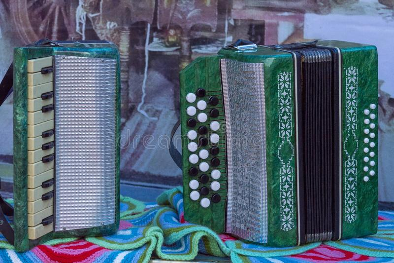 Bayan and accordion green on the table. stock photo