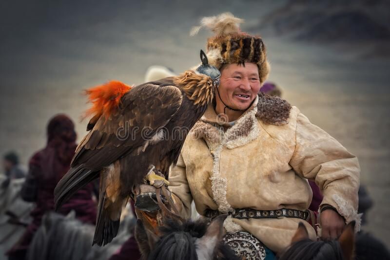 Bayan-Olgiy aimag, Western Mongolia - October 07,2018: Nomad Games, Altai Eagle Festival.Hunter With Silver Teeth Celebrating Vict royalty free stock image