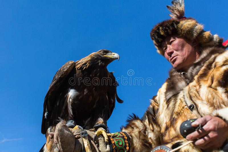Download Mongolian Kazakh Eagle Hunter Traditional Clothing, Holding A Golden Eagle On His Arm Editorial Image - Image of horse, hunter: 102458380