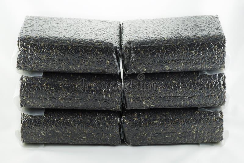 Bayas del arroz en el bolso de vacío foto de archivo libre de regalías