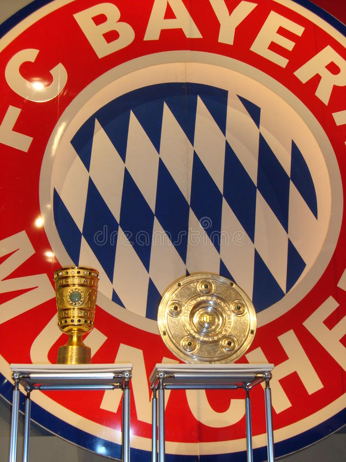 Bayern Munich Logo and trophies. Bayern Munich Logo and the two most important German soccer trophies at press conference royalty free stock images