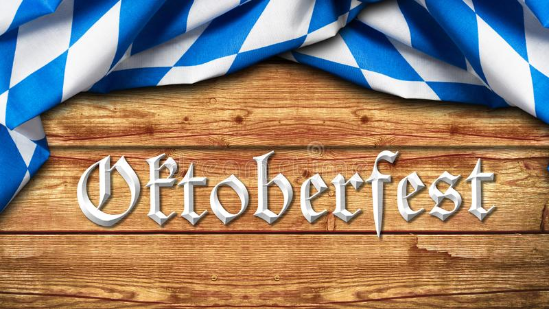 Bayersk bordduk och slogan 'Oktoberfest 'på träbakgrund royaltyfria bilder