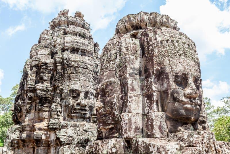 Bayon向面孔扔石头在吴哥窟,暹粒,柬埔寨耸立 库存图片