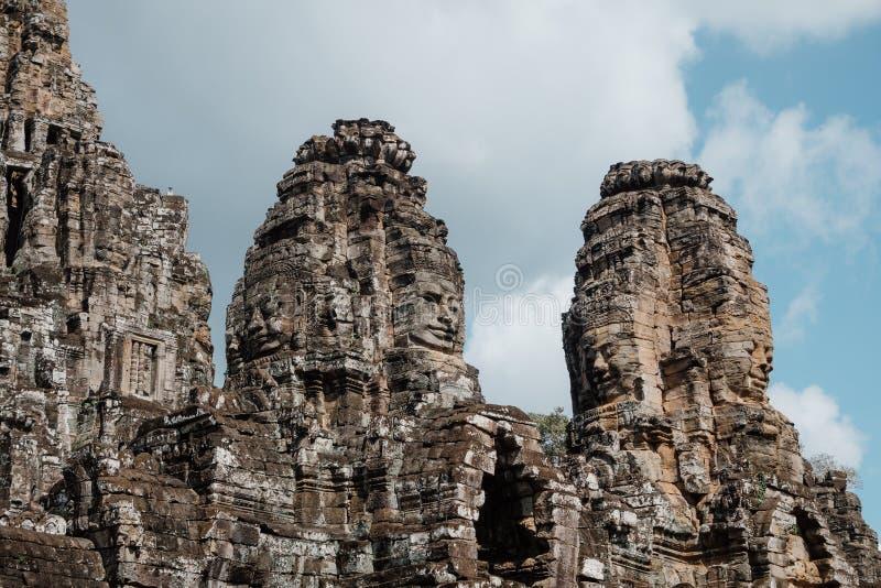 Bayon寺庙塔有微笑的菩萨的面对在吴哥城复合体,暹粒,柬埔寨 库存图片