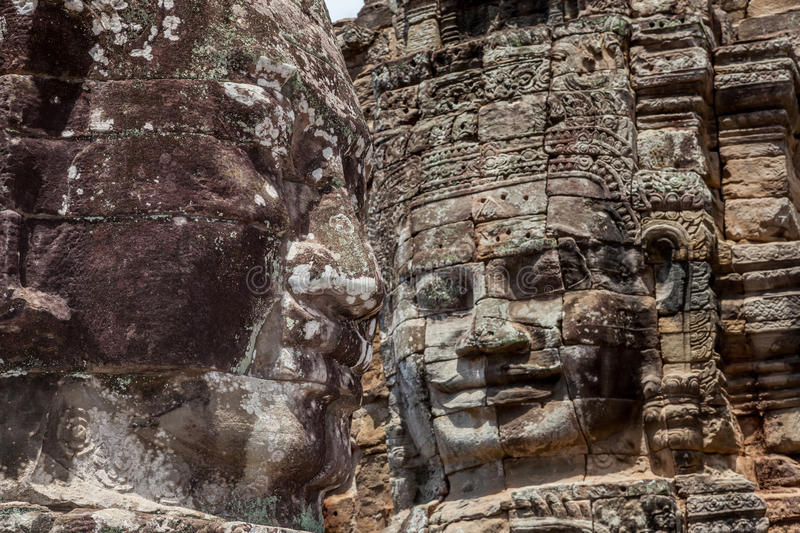 Bayon stone face tower in Angkor Wat, Siem Reap, Cambodia. The UNESCO world heritage, closeup the old stone face mural in Angkor Wat, Siem Reap, Cambodia royalty free stock photo