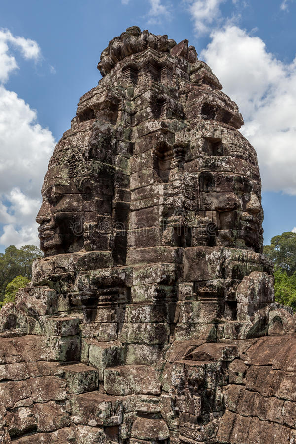 Bayon stone face tower in Angkor Wat, Siem Reap, Cambodia. The UNESCO world heritage, old stone face mural in Angkor Wat, Siem Reap, Cambodia stock photo
