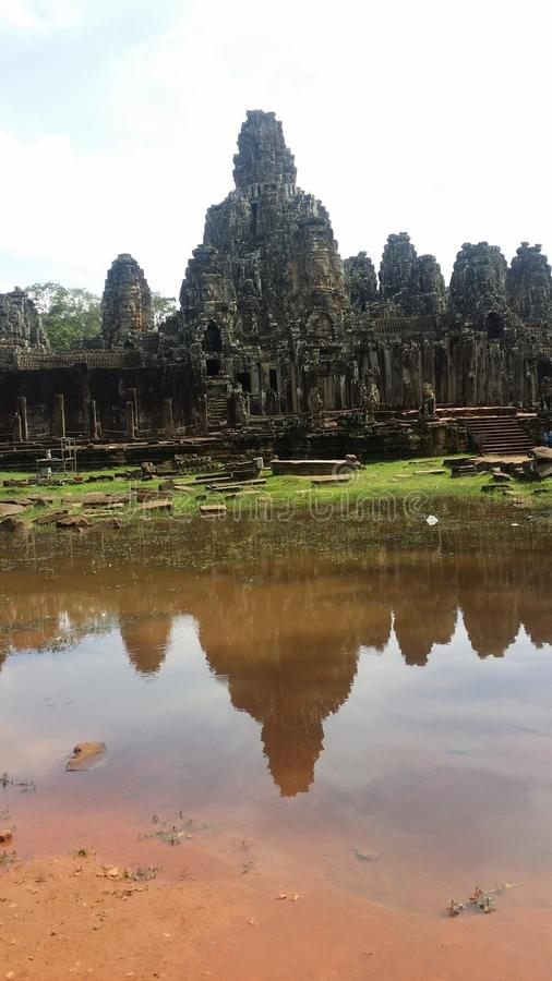 Bayon temple. Fronting a pond in Cambodia royalty free stock photos