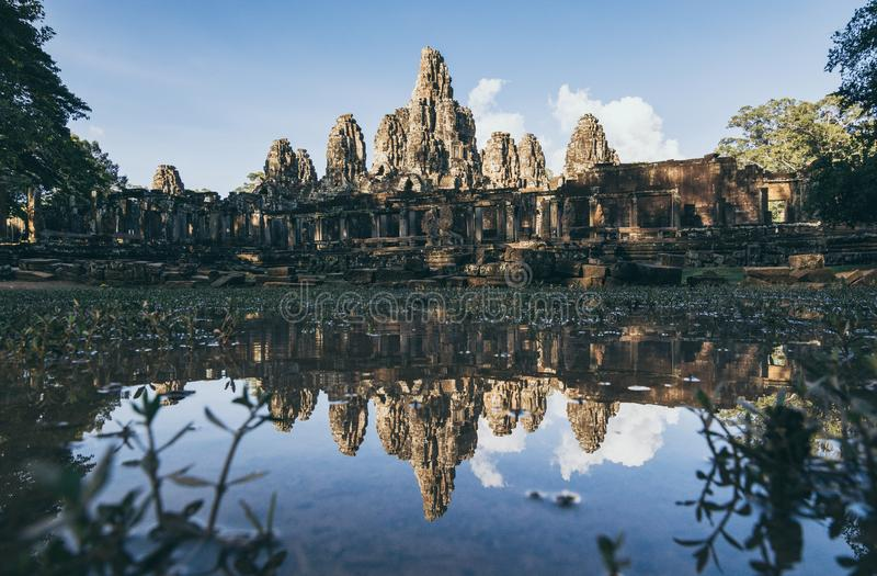Bayon Wat temple panoramic reflection in lake water at sunset, Cambodia. Angkor, mirror, parallel, symmetry, asia, asian, ancient, old, magnificent, eternal royalty free stock image