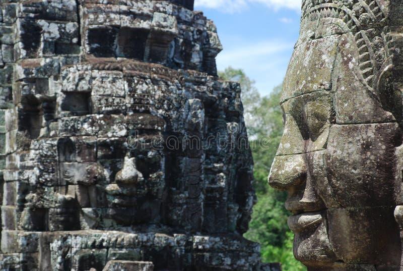 Den gåtfulla Bayon stenen vänder mot, Angkor tempel, Cambodja royaltyfri bild