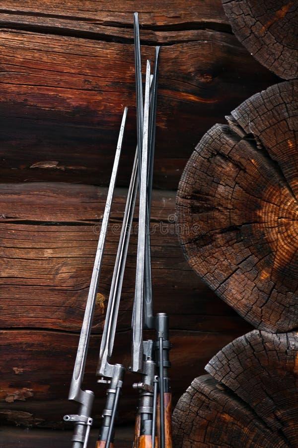 Bayonets. At the log walls stock images