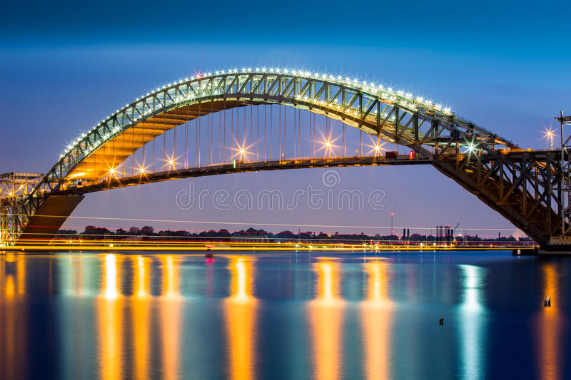 Bayonne Bridge at dusk. The Bayonne Bridge is the 5th longest steel arch bridge in the world, spans the Kill Van Kull and connects Bayonne, NJ with Staten stock images