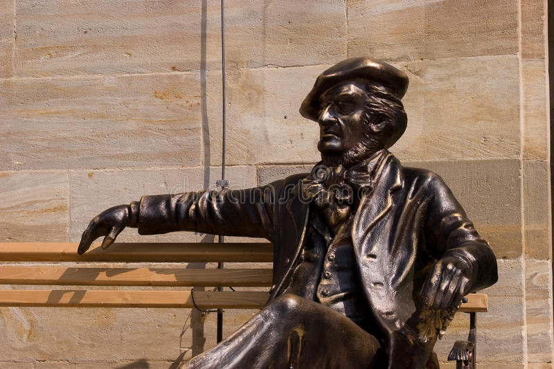 Bayreuth Is Celebrating Richard Wagner Jubilee. Sculpture of Richard Wagner sitting in on a bench in the city of Bayreuth Upper Franconia. On 22. May 2013 the stock image