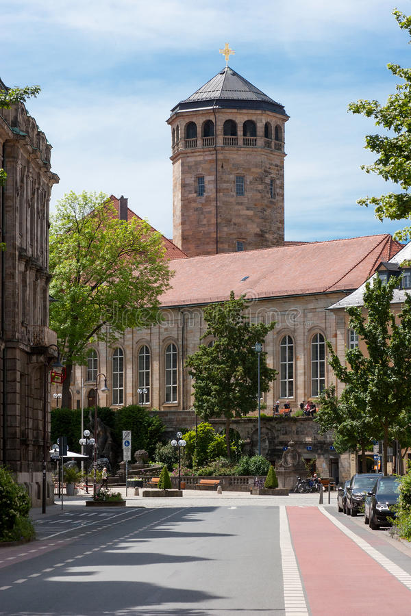 Bayreuth (Germany - Bavaria), Orthogonal church tower. View along street towards the orthogonal church tower of the old palace (Altes Schloss) in Bayreuth ( royalty free stock image