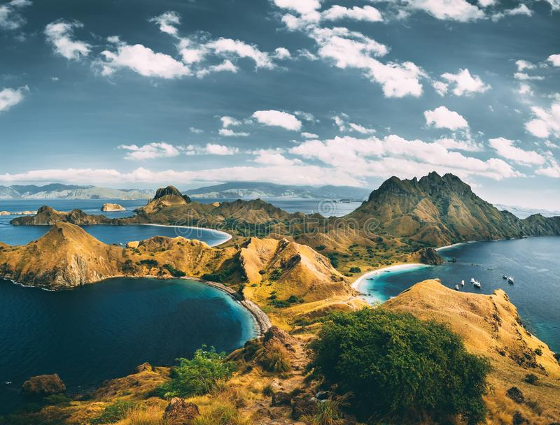 Bays, mountains, cloudy sky. Aerial shot. Padar. Spectacular panoramic overview the bays and mountains of the amazing Padar island of the Komodo National Park stock images