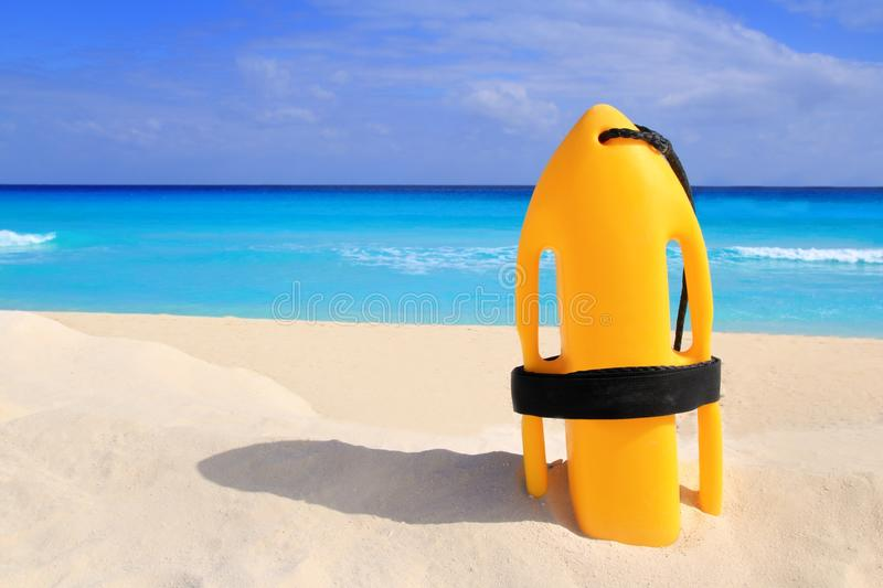 Download Baywatch Rescue Buoy Yellow On Tropical Beach Stock Image - Image: 18735621